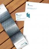 Letterhead, a standard business card and a folded business card